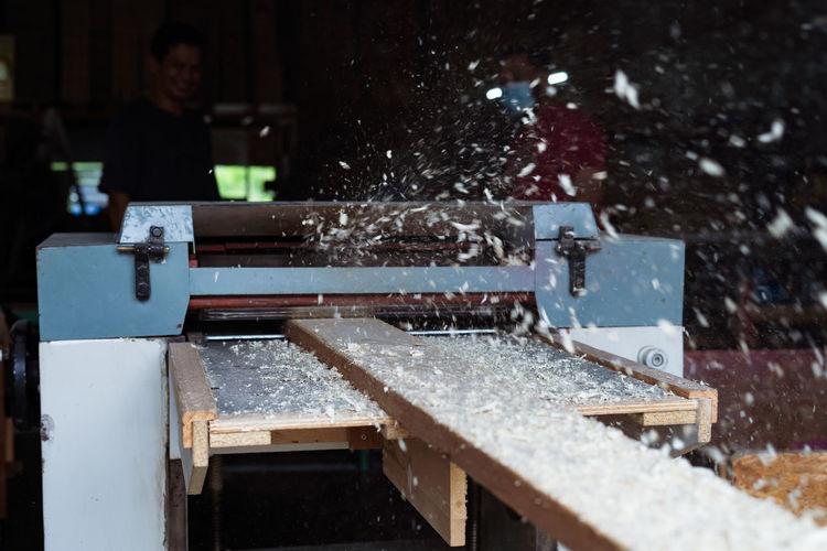 Defocused image of man working in factory