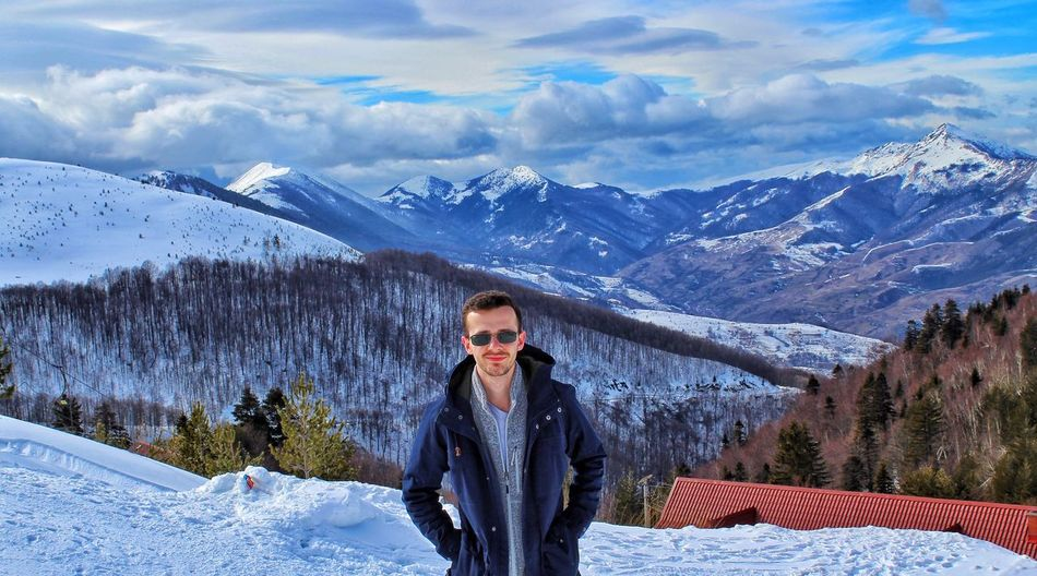 Winter Snow Cold Temperature Mountain Looking At Camera One Person Weather Warm Clothing Portrait Cloud - Sky One Man Only Nature Sky Mountain Range Front View Young Adult Only Men One Young Man Only Young Men Outdoors The Portraitist - 2018 EyeEm Awards The Modern Professional