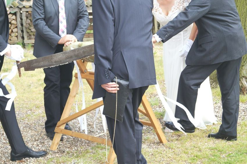 Saw it Men Suits  Dressed Up Wedding German Tradition Saw Wood Trunk Male Hands Working Groom Bride Wedding Dress Celebration Party Looking Close EyeEm Best Shots Happy Day White Ribbons Black Shoes Marriage  White Gloves Silhouettes The Photojournalist - 2016 EyeEm Awards EndlessLove