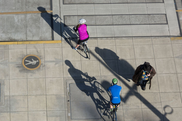 Adult Adults Only CyclingUnites Day Directly Above Full Length High Angle View Light And Shadow One Person Outdoors People Real People Shadow Sunlight Urban Transportation Women The City Light The Street Photographer - 2017 EyeEm Awards Let's Go. Together. Investing In Quality Of Life