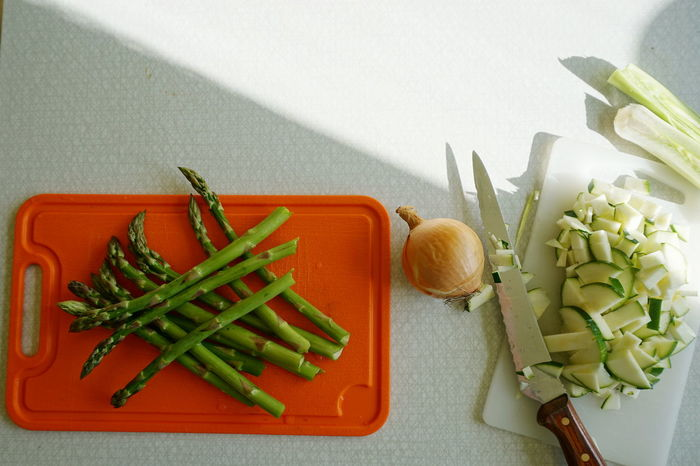 Cutting vegetables Asparagus Celery Close-up Cutting Cutting Board Day Food Food And Drink Freshness Green Color Healthy Eating Indoors  Knife No People Onion Orange Color Raw Food Squash Table Vegetable