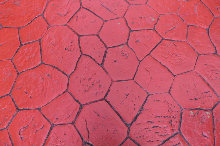 Arid Climate Backgrounds Close-up Day Design Environment Field Footpath Full Frame Geometric Shape Hexagon High Angle View Land Nature No People Outdoors Pattern Paving Stone Red Shape Textured