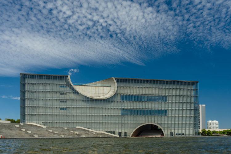 Building against cloudy sky