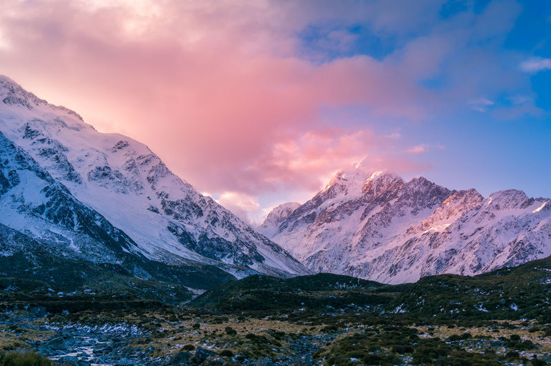 Winter mountain landscape with colorful clouds at sunset. snow covered mountains nature landscape