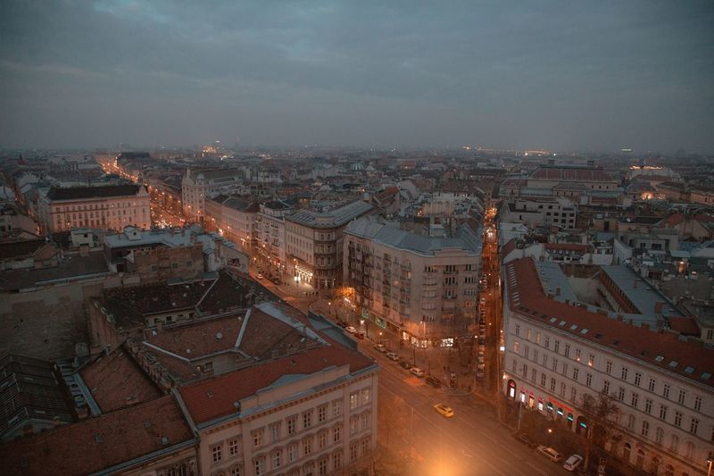 High angle view of illuminated city buildings at dusk