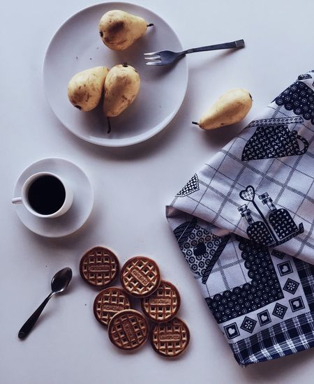 Directly Above Shot Of Black Coffee With Cookies And Pears On Table