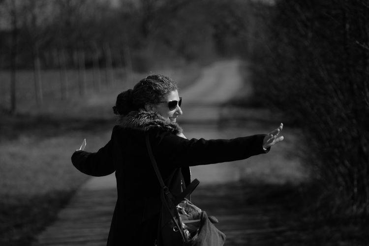 Smiling mature woman dancing in park