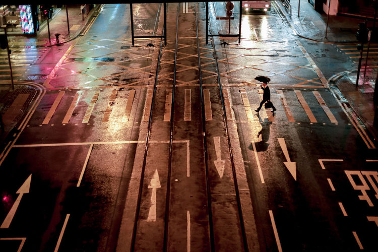 Hong Kong Raining Architecture Building Exterior Built Structure City City Life Crossing Day Full Length High Angle View Incidental People Outdoors People Real People Reflection Road Road Marking Street Transportation Walking Wet The Street Photographer - 2018 EyeEm Awards