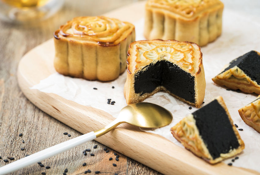In the Chinese tradition, the Mid-Autumn Festival, people need to eat moon cake. Close-up Day Food Food And Drink Freshness Indoors  No People Ready-to-eat Sweet Food Table Wood - Material