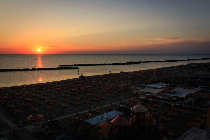 Sunrise on the beach of Torre Pedrera at Rimini in Italy Sky Water Sunset Sea Beach Scenics - Nature Land Nature Orange Color Beauty In Nature Horizon Architecture Horizon Over Water High Angle View Group Of People Crowd Cloud - Sky Outdoors Dusk Sunrise Adriatic Sea Sandy Beach Morning Tide Mediterranean Sea