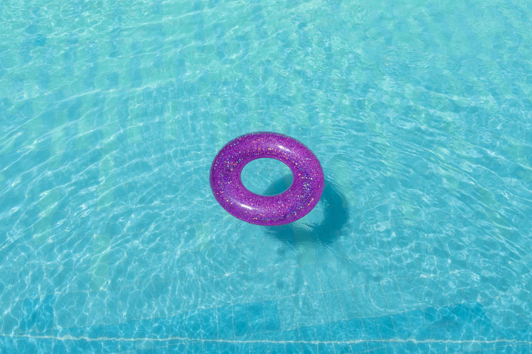 Pink donut floating in a pool Background Beauty Blue Calm Caribbean Colors Concept Cuba Cyan Day Donut Floating Fun Game Havana Holiday Holidays Hotel Hotel Pool Industry Inflatable Donut Multicolor Multicolored No People Outdoor Pink Pink Color Places Pool Relax Relaxation Safety Scene Sequins Spangle Sport Spring Summer Tourism Tourists Travel Travel Destination Urban Vacations Water Waves Swimming Pool Floating On Water High Angle View Nature Tube Tubing Waterfront Inflatable  Shape Circle Geometric Shape Security Rippled Outdoors Turquoise Colored