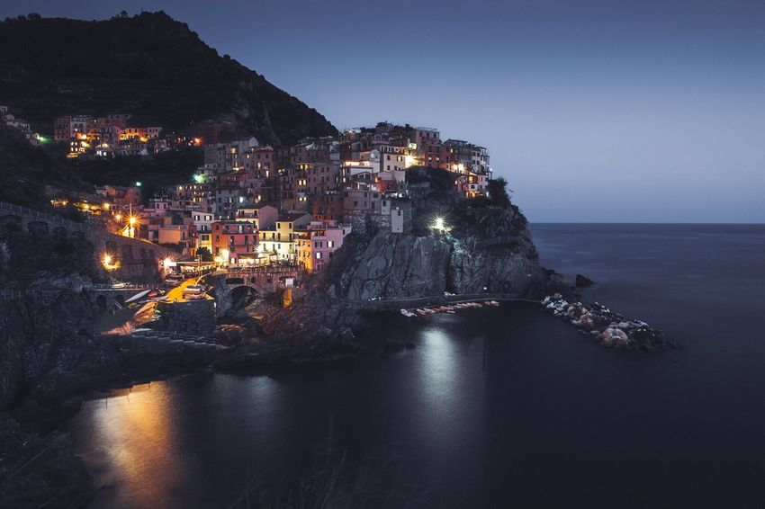 EyeEm Selects Sea Night No People Water Rock - Object Waterfront Outdoors Architecture Building Exterior Nature Illuminated Sky Built Structure Horizon Over Water Clear Sky Beauty In Nature Cinque Terre Cinqueterre Italy Italia Village Manarola, Cinqueterre
