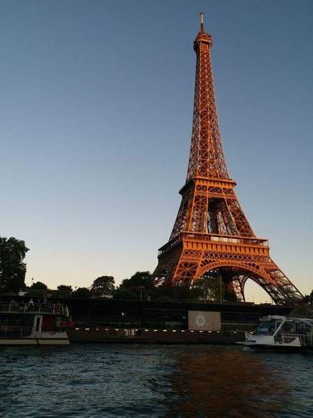 Paris Effieltower Evening Seineriver EyeEm Selects Europe City Water Cityscape Sunset Cultures History Urban Skyline Monument Tower River Tranquility Civilization Ancient Civilization Triangle Icon Calm Boat Moored Tranquil Scene Scenics Waterfront Architectural Feature Summer In The City