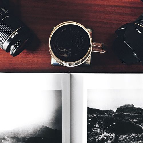 Good ideas start with great coffee. ☕️ Table Indoors  No People Technology Close-up Day Coffee Coffeetime Camera Coffee Table Book Specialtycoffee Flatlay Faded Food Brown Work First Eyeem Photo