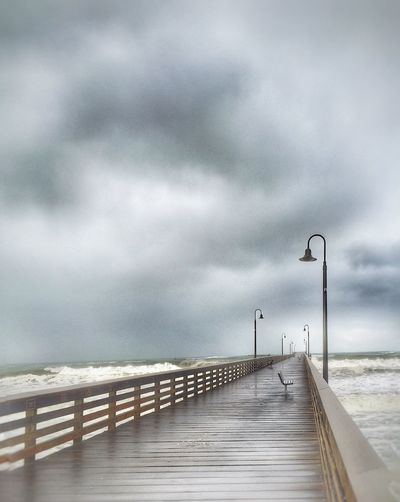 Empty pier on a stormy day... Railing Sea Sky Cloud - Sky Nature Outdoors No People Beauty In Nature Day The Way Forward Water Storm Cloud Beach Horizon Over Water Wave Cloudy Landscape_photography Nature Tranquility Solitude Storm Waves Waves, Ocean, Nature Mothernature