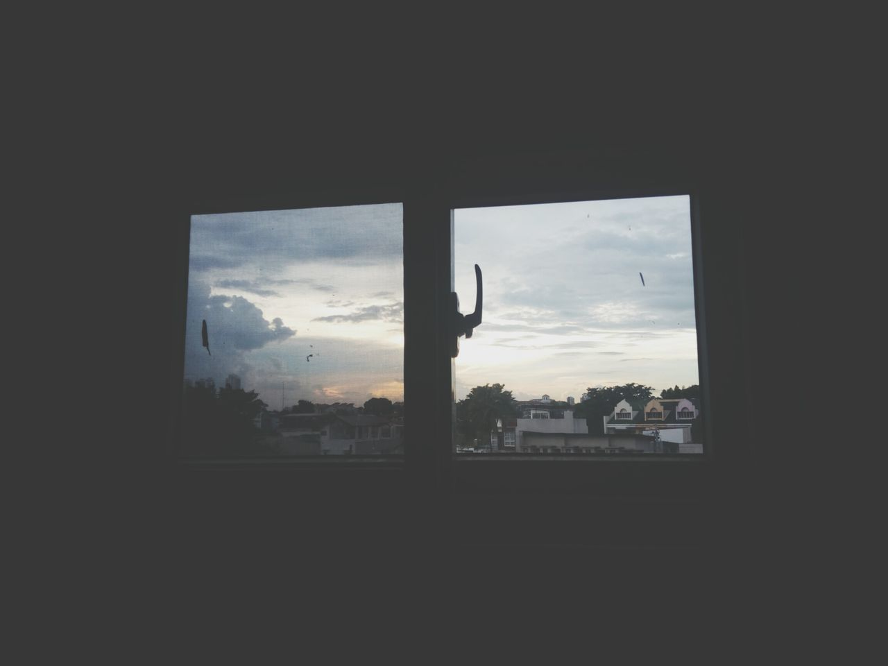 cloud - sky, sky, window, silhouette, nature, architecture, built structure, mountain, building exterior, tree, sunset, indoors, no people, landscape, beauty in nature, scenics, day, cityscape, city