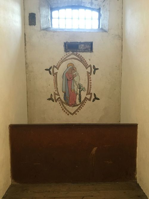 The cell of Mrs Joseph Plunkett, who married her husband the night before his execution for his part in the rising of 1916. She continued on in Irish politics after the death of her husband. She herself staunchly anti treaty, was later incarcerated in Kilmainham and painted this image of the Madonna and Child on her cell wall