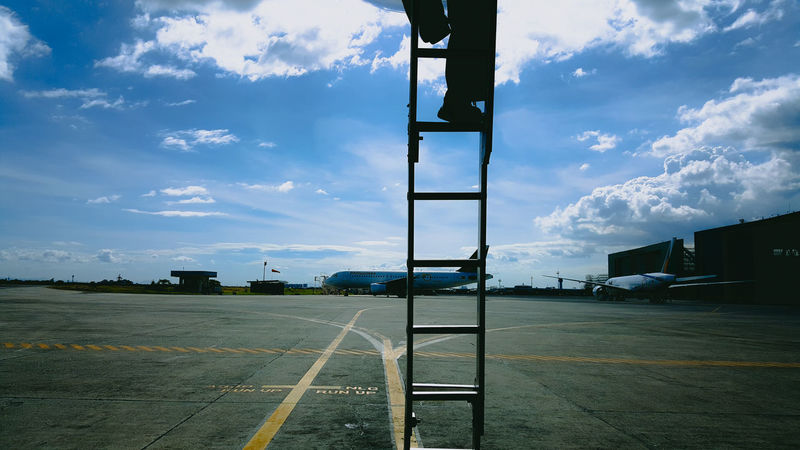 """""""What comes up must come down"""" Sky Cloud - Sky Outdoors Day No People Stair Stairs Airplane Pal Transportation NikonD7100 Philippines D7100 35mm Nikon Blue Blue Sky Yellow Yellow Line Feet Silhouette Samsung S6 S6edge"""