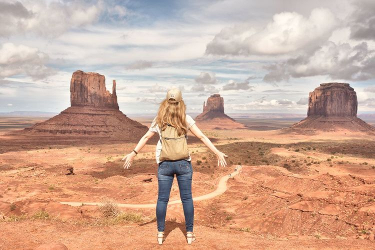 Beauty In Nature The Great Outdoors Amazing View Famous Place Cloud - Sky Travel Photography Mountain Travel Destinations Nikon USA Monument Valley Utah Arizona Navajo National Park Rock Formation One Person Standing Sand People