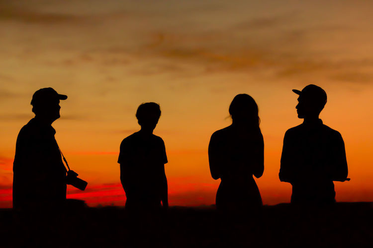 Enjoying The Sunset Orange Sky Outdoors People People Photography Silhouette Sunset Tadaa Community
