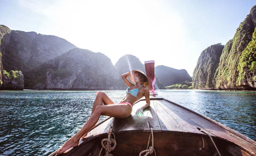 Woman on longtail boat in sea
