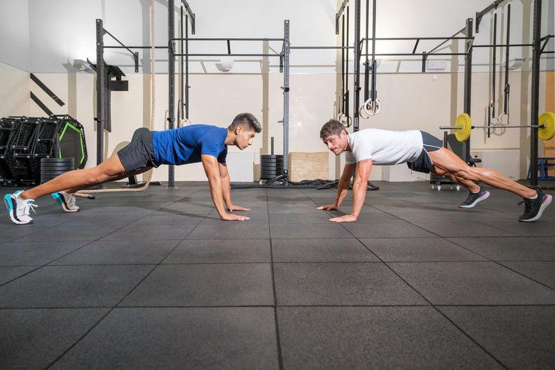 Men exercising at gym