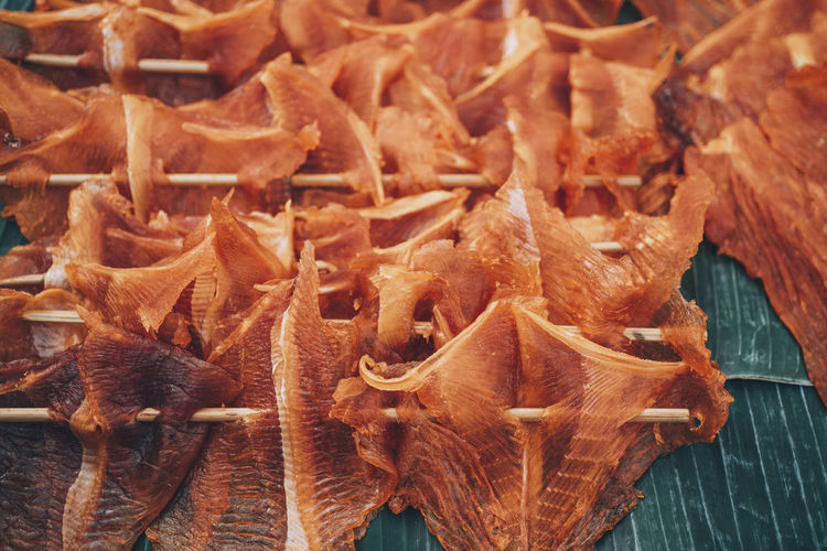High angle view of dried fish on stick for sale in market