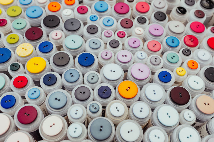 Buttons Multi Colored Large Group Of Objects Choice Variation Still Life Full Frame Backgrounds No People Indoors  Abundance Button Collection Sewing DIY Homemade Arrangement Sewing Item Thread Spool Close-up Stack Textile Art And Craft Order