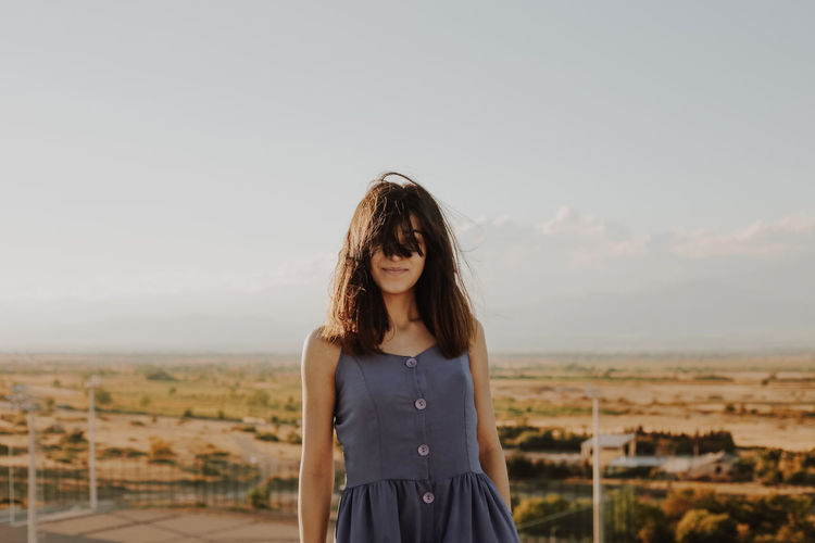 Beautiful Woman Beauty Brown Hair Casual Clothing Contemplation Copy Space Focus On Foreground Front View Hair Hairstyle Leisure Activity Lifestyles Long Hair Looking Nature One Person Outdoors Portrait Sky Standing Waist Up Young Adult The Traveler - 2018 EyeEm Awards
