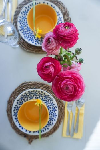 table setting for spring and easter Holiday Decoration Dinner Time Dinner Time Table Table Setting Bouquet Of Flowers Ranunculus Pink Pink Flower Yellow Yellow Color Directly Above Bowl Plate Plates Table Setting Setting The Table Directly Above White Background Flower Rose - Flower High Angle View Close-up Served Blooming Vase