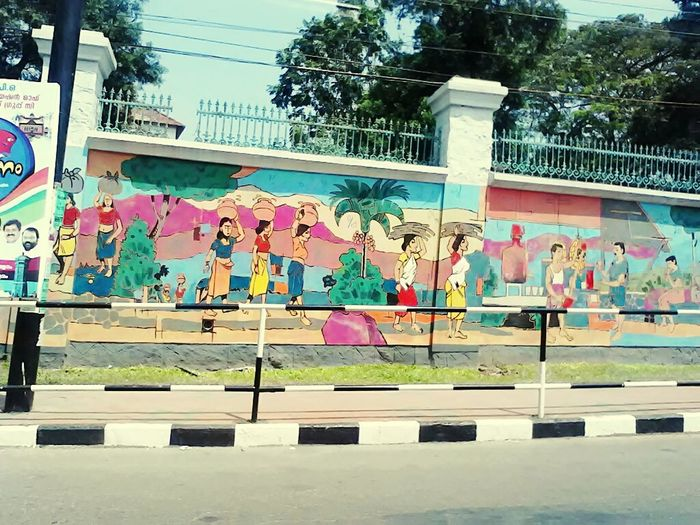 Graffiti Day Multi Colored Street Art Outdoors Built Structure Painterly Painted Image Workers At Work Womenattire Womanatwork Fetching Water Matka Earthernpots Kerala India Keraladiaries Road Of Kerala Kerala Style Keralaspecial