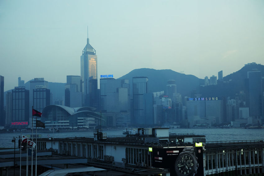Star Ferry Pier and Skyline of Hong Kong at Dusk - Hong Kong Island, China, Asia Architecture Building Exterior Business Business Finance And Industry China City Cityscape Downtown Downtown District Dusk Hong Kong Hong Kong Island HongKong Modern Office Building Panorama Pier Silhouette Skyline Skyscraper Star Ferry Star Ferry Pier Travel Destinations Urban Skyline Waterfront