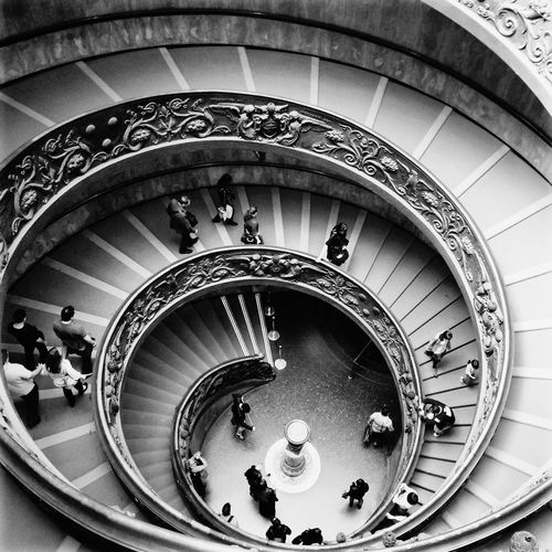 People Walking At Spiral Staircase In Vatican Museums