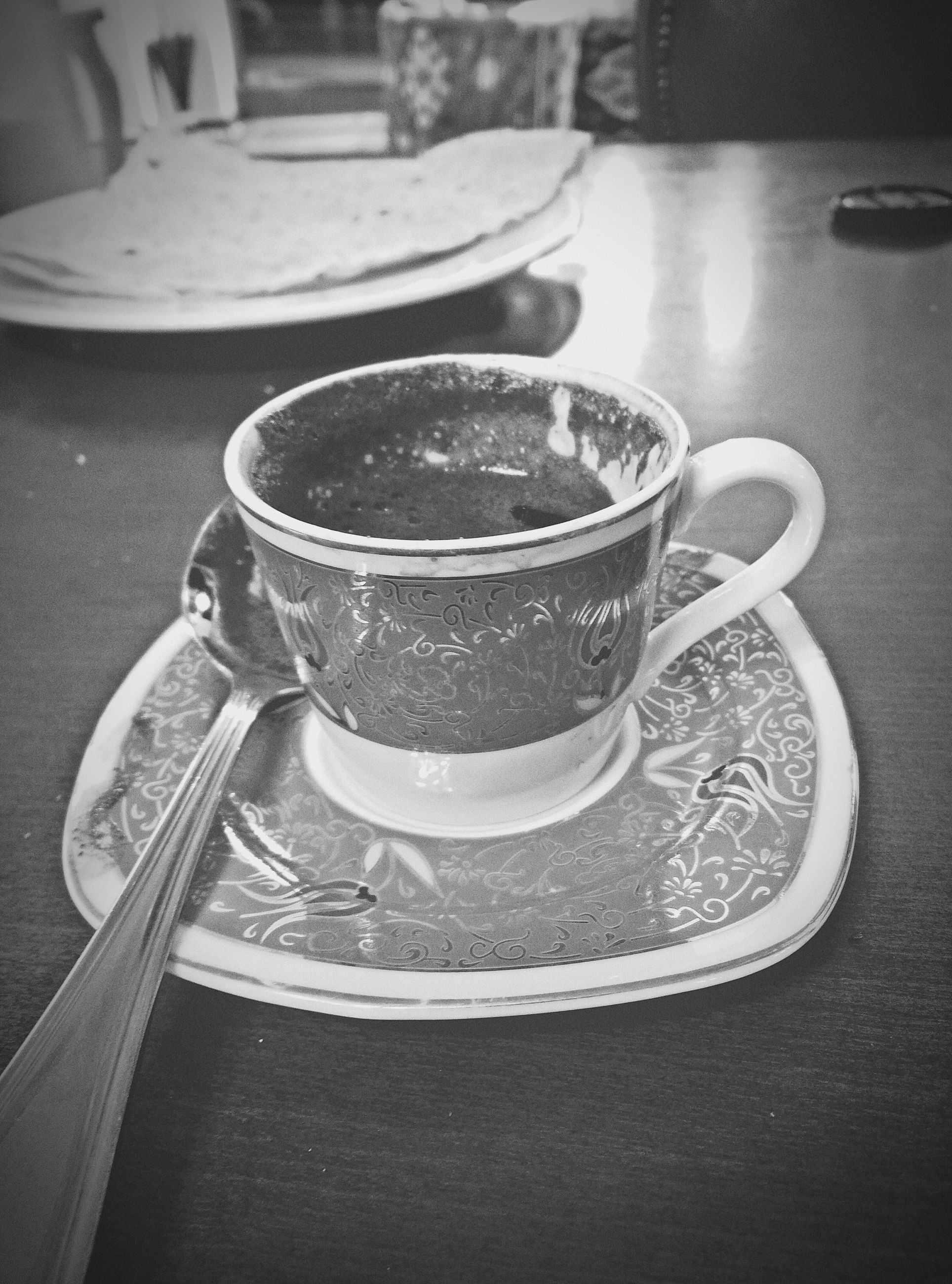 close-up, indoors, table, still life, no people, day, metal, focus on foreground, high angle view, street, sunlight, drink, food and drink, reflection, empty, coffee cup, container, shadow, glass - material