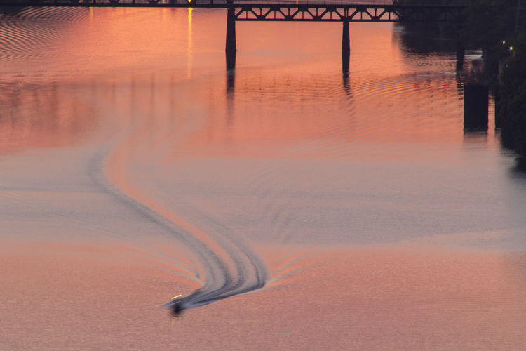 High Angle View Of Boat In Ohio River During Sunset
