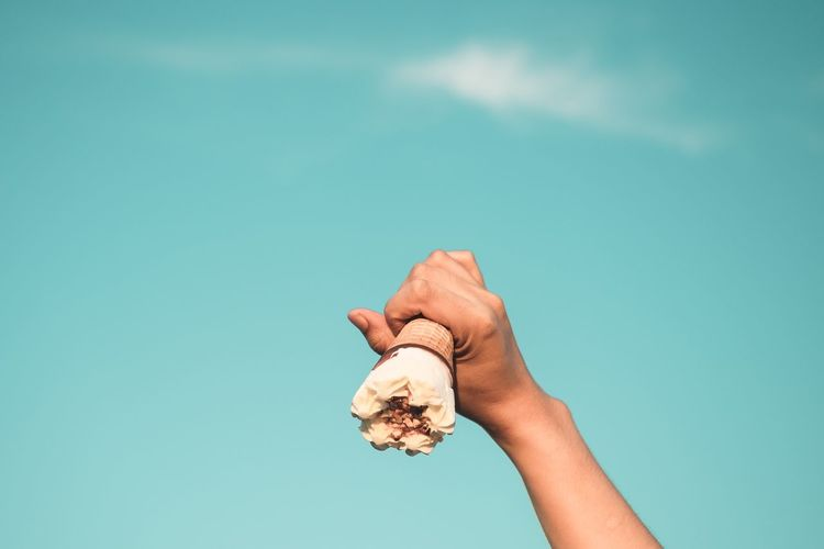 Hand holding ice cream against vintage sky Human Hand Hand Holding Sky Blue Copy Space Close-up Minimalism Ice Cream Food Minimal Conceptual Photography Chocolate Day Summer Color Image Dessert Food And Drink Freshness Horizontal Object Sweet Food Vintage Creative Idea Perspective Beauty In Nature