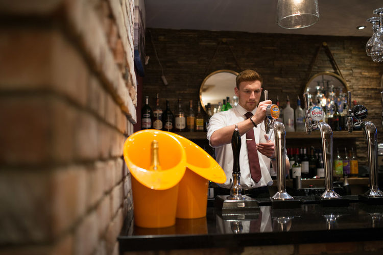 Barman pulling a pint in a restaurant/bar Bar Barman Beer Brick Wall Champagne Nightclub Pint Restaurant