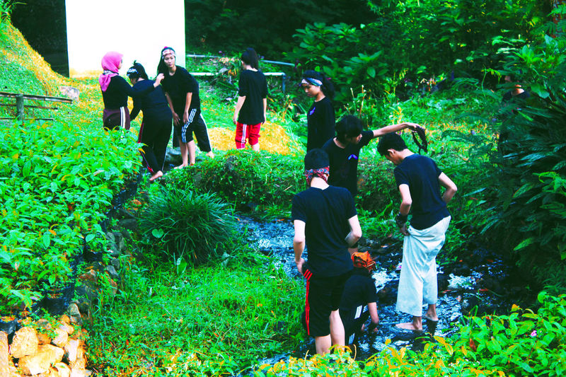 College Theather kids clean body in the small river College Students Theather River INDONESIA Waterfall Forest Tree Green Color Men Growth Outdoors People Grass Nature Day Participant Young Water Uniqueness