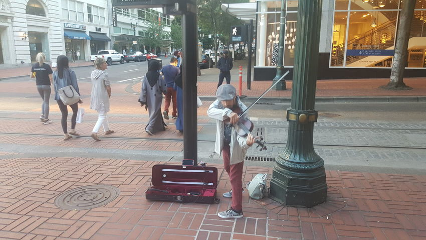My boyfriend of 2 months now is a street musician in downtown Portland. Here he is playing his violin beautifully for passers-by. No Edit/no Filter City Streets