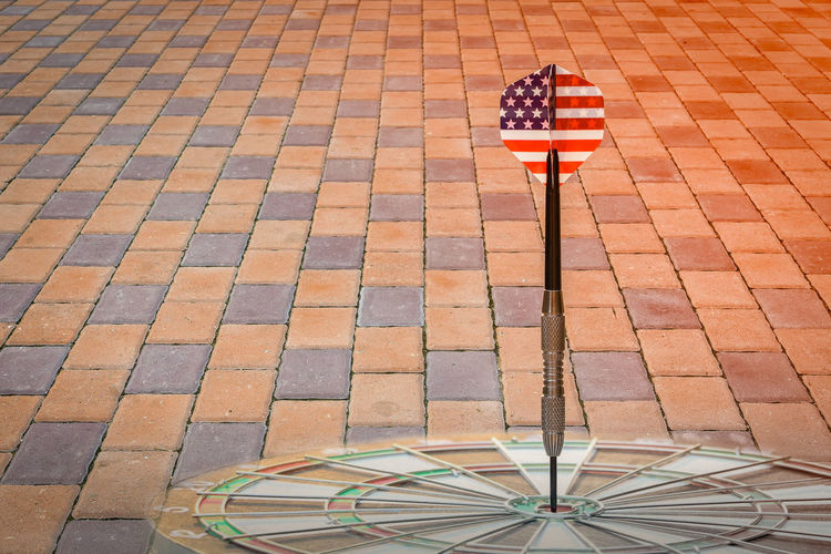 High angle view of flag on footpath