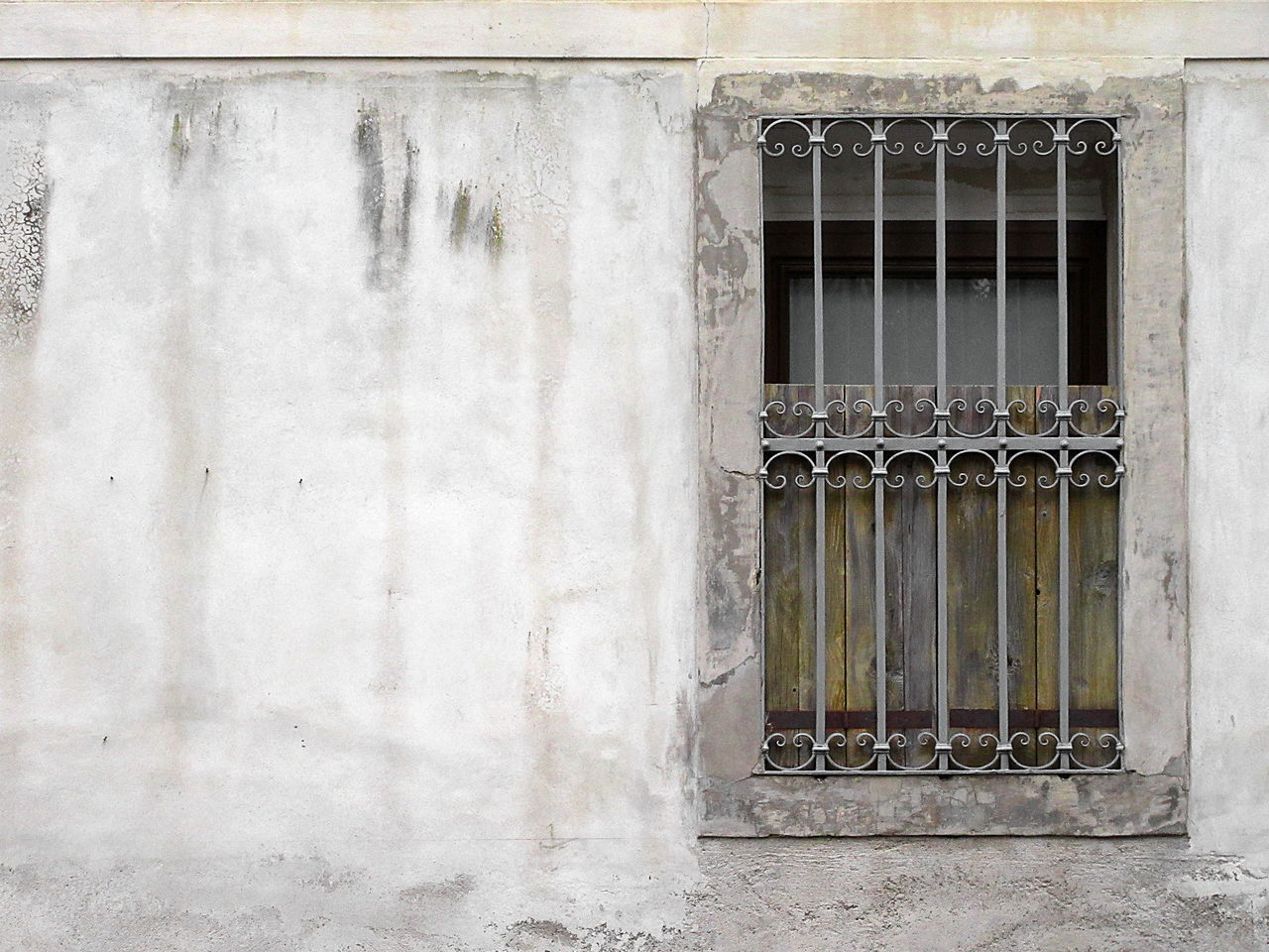 Window On Wall Of Old House