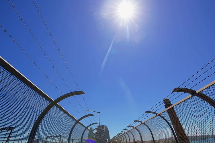 Freedom Architecture Background Behind Fence Blue Built Structure Cable Clear Sky Day Desire Fences Full Frame Hoping  Lens Flare Let Me Free Locked Up Low Angle View No People Outdoors Sky Sun Sunlight Sunshine