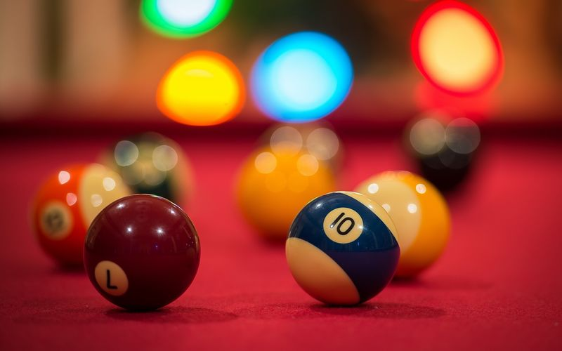 Close-Up Of Colorful Pool Balls On Table