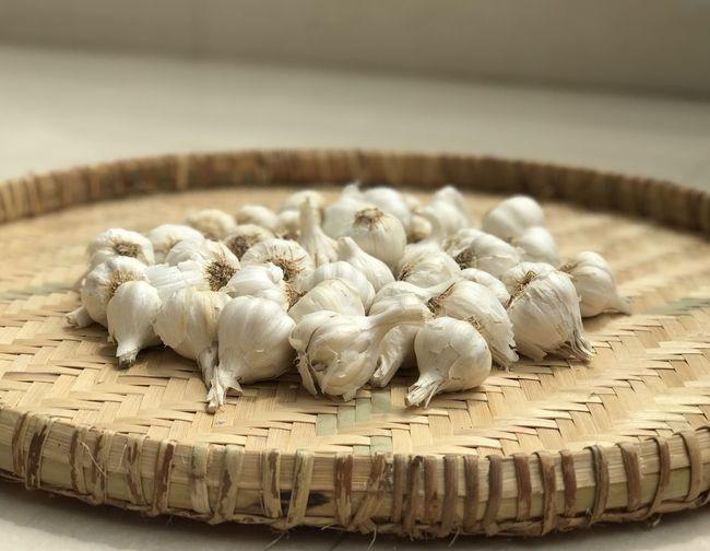 Close-up of garlic bulbs in basket at home