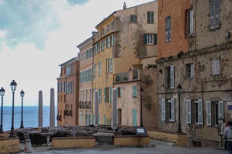 Residential buildings against sky in city