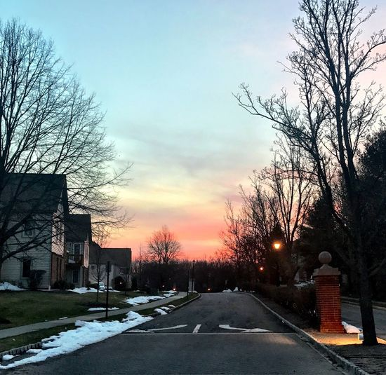 Tree Bare Tree Sky Road Transportation Building Exterior Sunset No People Outdoors Architecture Built Structure Car Land Vehicle Cold Temperature The Way Forward Winter Snow Nature City Day
