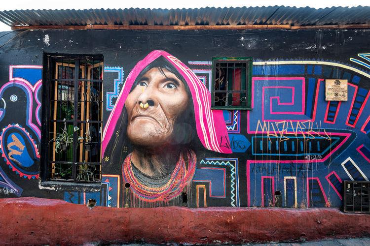 Portrait of mid adult man against graffiti on wall