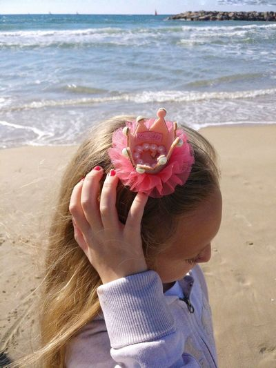 Close-up of girl hair clip standing at beach on sunny day