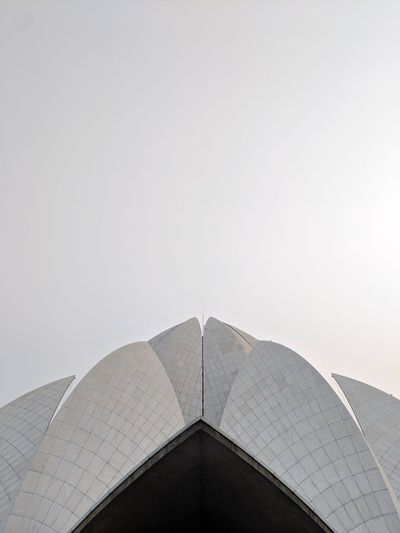 Low angle view of lotus temple against clear sky