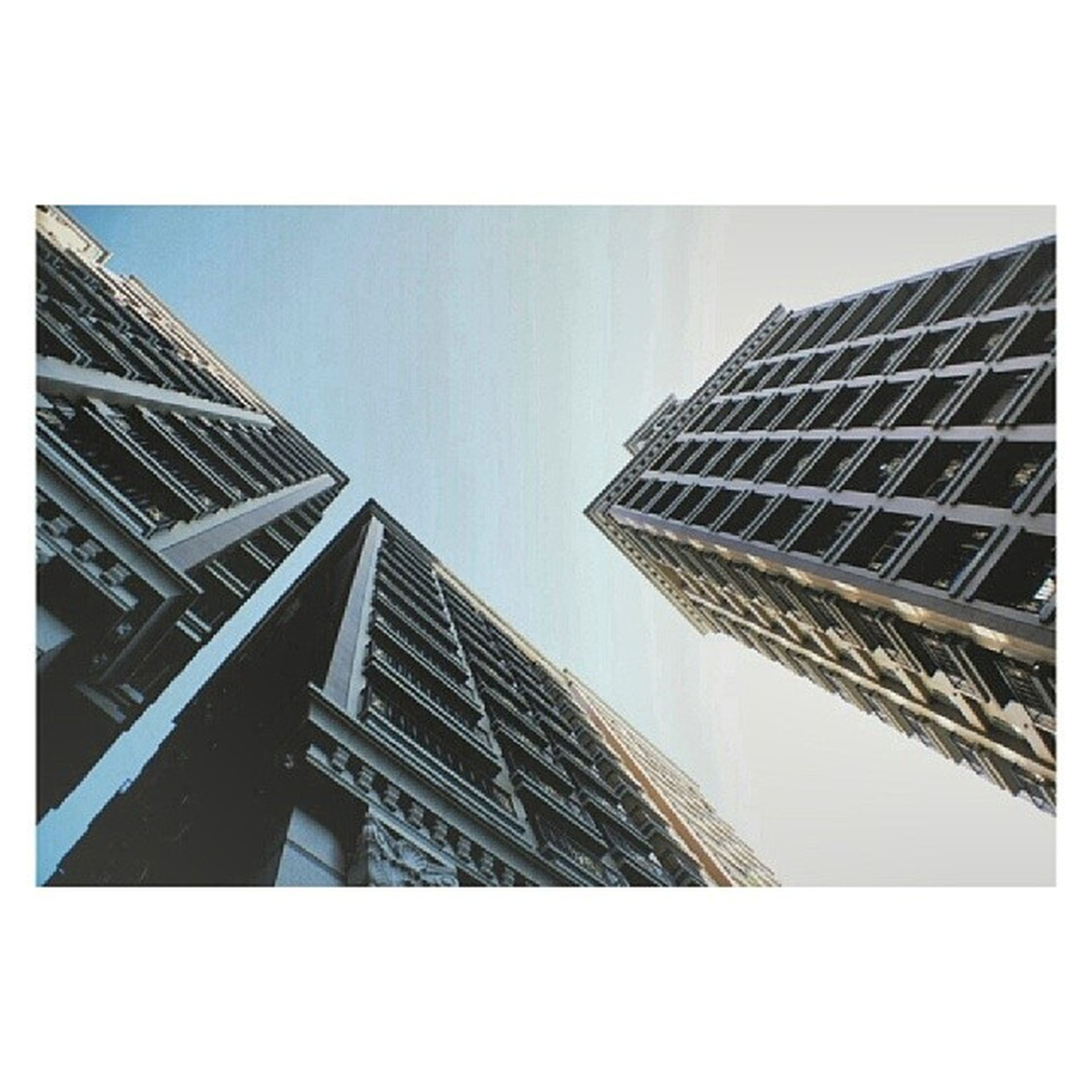 transfer print, architecture, building exterior, built structure, low angle view, auto post production filter, office building, modern, skyscraper, city, tall - high, tower, clear sky, building, glass - material, reflection, sky, tall, day, window